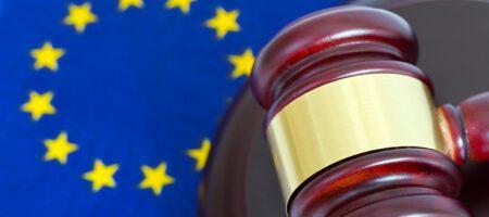European legislation. Motif with EU flag and legal hammer