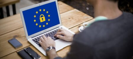 EU logo with a lock in the middle on a computer screen